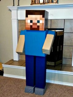 Life-size Minecraft Steve made with cardboard boxes and fabric. Steve is almost 5 feet tall! Great for a decoration at a birthday party or bedroom.