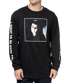 """Change up your outfits with the new long sleeve design of the Lydia t-shirt from Flying Coffin. Work this sleek black colorway into any outfit to show off the Lydia from Beetlejuice graphic on the chest and a green """"I Want To Be Dead"""" text graphics down b"""