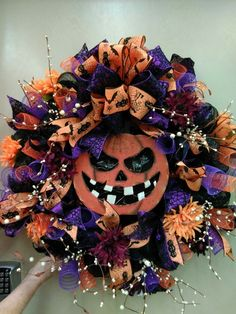 jack o lantern wreath by susie l in our ft myers fl store visit your local ac moore store to find more designer floral inspiration halloween wreath