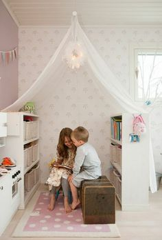This would be so much better than the kids' stuff taking up the entire bonus room! Cute little nook.