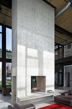 double-height concrete fireplace