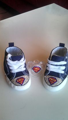 9f0370b56821 Items similar to Superman Symbol inspired Swarovski Crystal Converse crib  shoes and pacifier set on Etsy