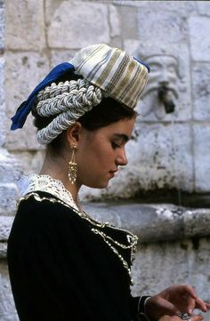 Woman in Scanno, wearing traditional costume. The costumes, like the Scannese themselves, originated in Asia Minor.