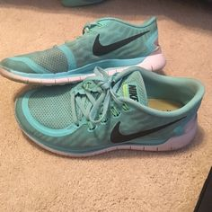 NIKE FREE 5.0 Great condition for the show in general! There are stains on the shoes and the toe pick is scuffed Nike Shoes Sneakers