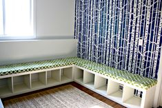 Expedit from IKEA turned on its side to create seating and storage. Genius! IHeart Organizing: Playroom Progress: A Bunch of Baskets!