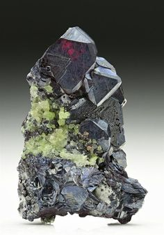 Intergrown maroon-red crystals of Cuprite form Tsumeb Mine. Crystal Classics Minerals