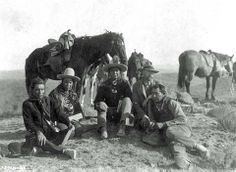 Three of Custer's scouts accompanying Edward Curtis on his investigative tour of the battlefield, circa 1907. Left to right: Goes Ahead, Hairy Moccasin, White Man Runs Him, Curtis and Alexander B. Upshaw (Curtis' assistant and Crow interpreter). - Photo by Edward S. Curtis, ca. 1907. - (Photoshoped copy)