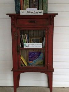 Maybe you have a covered porch – what about re-purposing a cabinet or night stand, setting it on your porch and filling it with books instead?