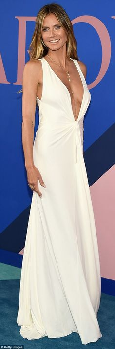 What a body: The former Victoria's Secret model, 44, chose an extremely low-cut white gown...