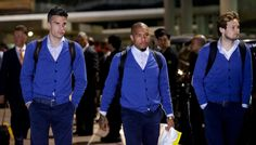 The Netherlands National Football Team walk the tarmac in Brazil.