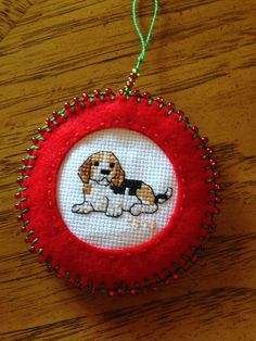 Side 1: Beagle Christmas ornament made for Mom, Dec. 2013. Cross stitch beagle on this side, pictures of Ranger on the other side.