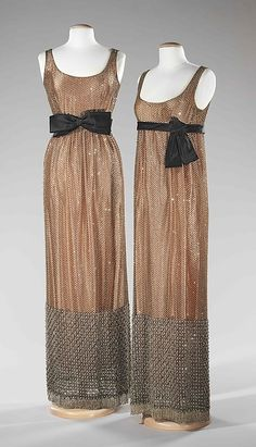 Rhinestone-embellished silk evening dresses with black satin sashes, by Norman Norell, American, ca. 1963.