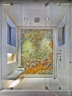 A slab of natural stone on the back wall of a shower is very dramatic.