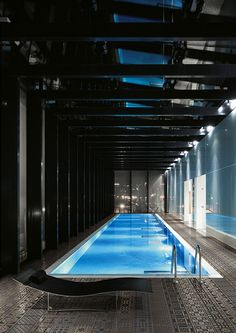 Indoor lap pool. Love the decking here!