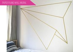 DIY + Paper Plane Wall Mural | Geometric feature wall out of washi tape or gold masking tape. Perfect for renters like us! | CAROLE + ELLIE