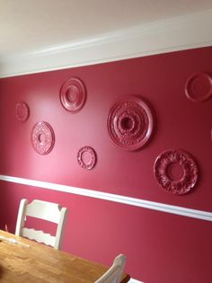 ceiling medallions put on the wall with caulking and then painted the same color of the wall! This was so easy to do!