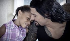 Joe Anoa'i (Roman Reigns)  his daughter Joelle shooting a commercial for the Ad Council promoting fathers spending time with their children