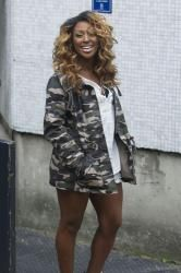 Alexandra Burke tries out the Camo jacket trend. Get the look now