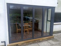 Visofold 1000 bi fold doors, Alitherm 800 windows recently installed at a local property. The structural steel column is covered with an insulated pressing on both sides to seamlessly connect the corner frame work between the bi fold door and adjoining window.