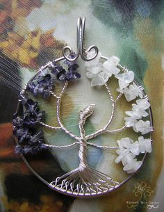 Wings of Freedom (Version Two)    This Tree of Life pendant was inspired by the anime, Attack On Titan. For the colors of the wings, I used