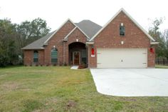 1000 images about paint garage door on pinterest red for Custom built brick homes