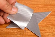 Make ninja stars! Cut out 2 diamond shaped pieces out of cardboard & cover with duct tape. Stack one on top of the other, forming them into an X shape. Put a piece of duct tape over top of them on each side, fastening them together.