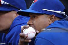 Marcus Stroman #54 of the Toronto Blue Jays looks on from the top step of the…