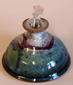 This piece of pottery was uniquely handcrafted in the mountains of North Carolina. Equivalent to a votive candle in oil lamp form. Burns for around 8 hours when filled with smokeless, odorless lamp oil. $13.50 Oil Candles, Votive Candles, 8 Hours, Oil Lamps, Store Fronts, Chandelier Lighting, Lamp Light, Creative Art, North Carolina