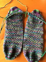 This sock is built on a easily remembered 4 stitch, 4 row pattern repeat that works up the top of the foot, and up the whole leg. The use of slipped stitches means this fabric has a nice, fitted and cozy feel, that still stretches to accommodate everything a good pair of socks should!