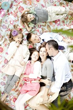 Blush, peaches and gray with a pop of green. Beautiful family portraits done by Ashlee Raubach