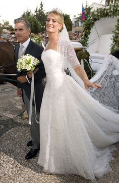 The beautiful bride arriving at the church with her stepfather, Attilio Brillembourg.