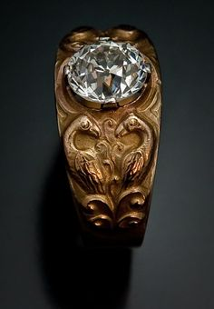 A Very Fine Antique Men's Gold Ring in Medieval Russian Style made in Moscow between 1908 and 1917 56 zolotniks gold (14K-583), one Old European cut brilli
