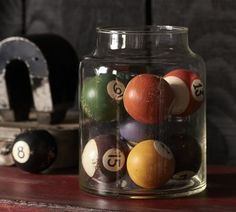 Great man cave idea: Fill a large jar with old billiard / pool balls for an interesting display.