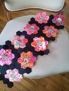 """Sneak peek of my quilts beginnings! Hand sewn w 1"""" hexagons. The method is English Paper Piecing."""