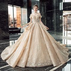 Luxury / Gorgeous Champagne Wedding Dresses 2019 Ball Gown Off-The-Shoulder Short Sleeve Backless Appliques Lace Sequins Beading Glitter Tulle Cathedral Train Source by iveaul Dresses Wedding Dresses With Flowers, Wedding Dresses 2018, Gown Wedding, Tulle Ball Gown, Ball Gowns, Dress With Shawl, The Dress, Pretty Dresses, Cathedral Train