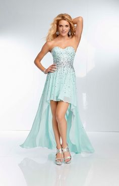 This Paparazzi 95096 gown is just stunning! We are loving this sexy little number! This dress has a sweetheart neckline, beadwork around the bodice, and a fabulously trendy high to low skirt. This gown is made of chiffon and will be the perfect gown for your next homecoming, prom, or formal event!
