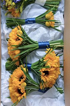 Sunflower bouquets all boxed and ready to go for our wedding. http://fioribylynne-weddingflowers.blogspot.com/2012/02/emmas-yellow-and-blue-wedding-flowers.html