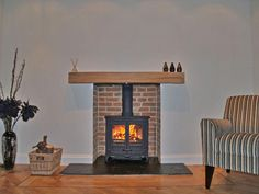 Reclaimed brick slip chamber with new clad oak beam, slate tiled hearth and Charnwood Island 1 multi fuel stove. Fitted in Upminster Essex 2006