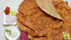 Pakistani Bread - Recipes for Katlama ....The original katlama, topped with spices and besan is usually eaten on its own. Sometimes with chutney or raita or whatever you like. You can try the different varieties of like Achari Lal Mirch or Aloo katlama,the Tamatar Feta Cheese katlama .For meat lovers, there's Keema katlama, the Murgh Gilafi to name just a few. All these scrumptious, authentic katlamas will be served with a Vegetable Korma or a Rogan Korma respectively.