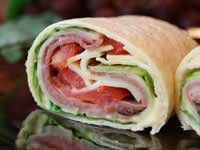 THAT'S A WRAP: HOW TO MAKE A SANDWICH WRAP - Wraps are versatile with something for everyone and every occasion.  Load them with meats, cheese, and veggies to suit.  Spread them with mayonnaise or a sandwich spread or drizzle them with dressing. For breakfast, you can fill them with scrambled eggs, grated cheese, and snipped bacon or crumbled sausage.  Add salsa if you like for a Tex-Mex breakfast burrito.