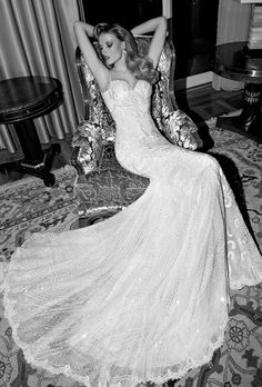 Brides: Galia Lahav. Audrey is a light ivory dress embroidered with wrought iron motifs. It has a tulip shaped silhouette and a U-shaped low back. The back is made in sheer fabric displaying a bare back illusion. The shoulders of the gown are detailed with wrought iron details.The back of gown is outlined with tiny crystal faceted gems. The godet of the skirt are constructed as waves of iridescent sequins and ivory pearls.moreless