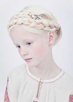 Slavic girl with white blonde hair and ivory skin.