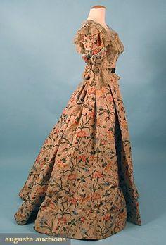 """SILK CHINE TEA GOWN, c 1900 2 piece, multi-color floral chine print on tan silk faille, bodice w/ net & chiffon, ruched blue silk, black velvet bands, paste buckles, detached petersham, """"Jennings & Co. NY"""", B 36"""", W 22"""", Front Skirt L 40"""", Back Skirt L 45"""",(damage to linings & chiffon on sleeves) excellent."""