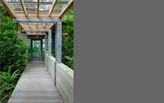 Steel concrete wood glass and forest of course  Cutler Anderson Architects