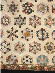 A Grandmother's flower garden patchwork coverlet, with hexagonal medallions composed of a variety printed cottons, with white ribbed cotton . Old Quilts, Antique Quilts, Scrappy Quilts, Vintage Quilts, Primitive Quilts, Paper Piecing Patterns, Quilt Patterns, Hexagon Quilt, Hexagon Patchwork