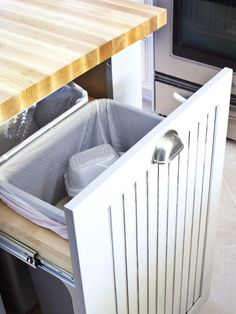 Keep your trash and recycling separate with double pull-out bins. >> http://www.hgtvremodels.com/kitchens/50s-kitchen-now-open-for-cooking/index.html?soc=pinterest