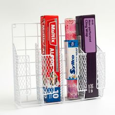Wrap Organiser. Kitchen organisation. Cling wrap, wax paper, tin foil. Made of metal and powder coated, this organiser is easy to clean and install.