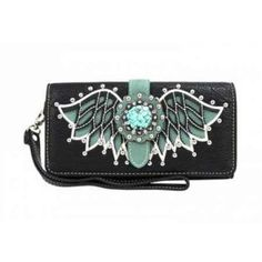 Made of PU leather, this tri-fold clutch/wallet wristlet has: •Cut-out wing design outlined with silver embellishments •A silver floral rhinestones concho •Single removeable strap to convert the wallet into a wristlet •A zippered pocket on the back •Pocket on the inside for ID, credit cards, cash and more approx. 7.5 x 1 x 4        price 21.95 order online: http://endlessxpressions.com/store/#charmers