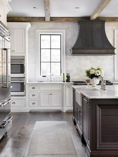 Floor, cabinets, backsplash, countertops, hood.  |  L. Kae Interiors