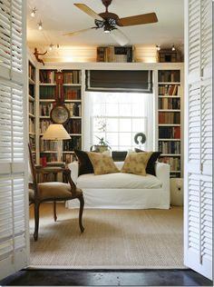 This study by Ashley Goforth reminded me of what mine will look like – the shelves over the window and down the sides, the seagrass, the white slips. Simple and clean. I like the shutter doors too.